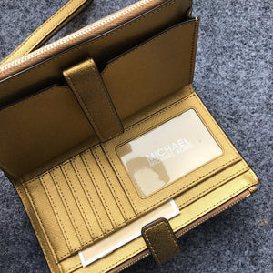 MICHAEL KORS JET SET TRAVEL LARGE DOUBLE ZIP (OLD GOLD)