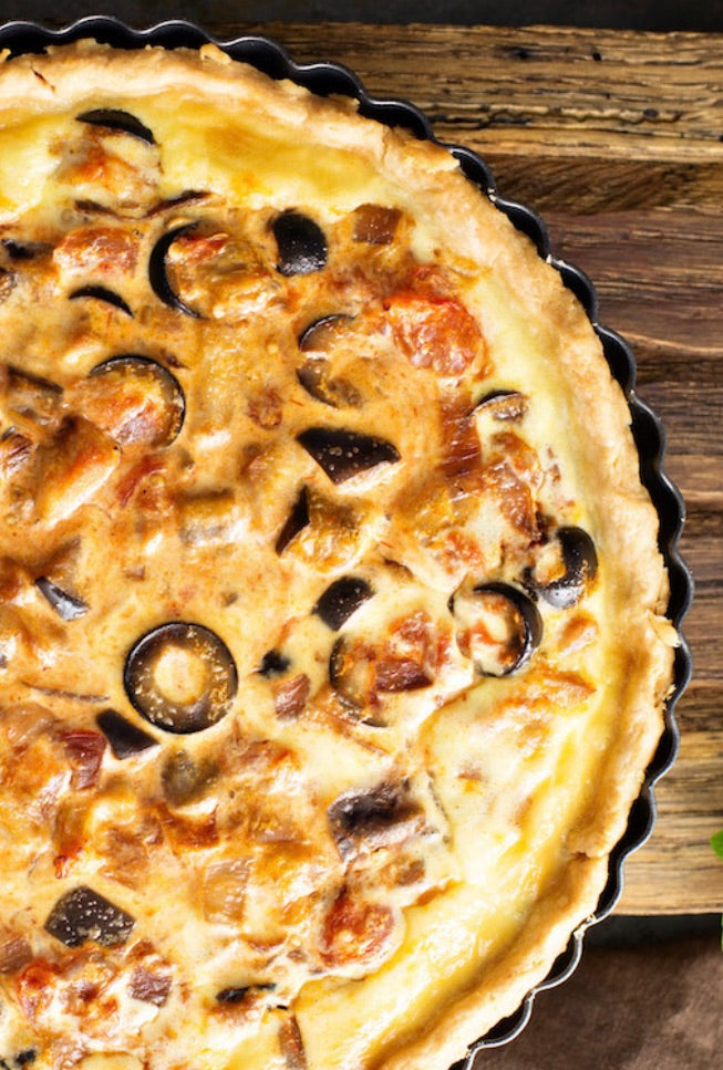 Caramelised onion tart with olives and Brie