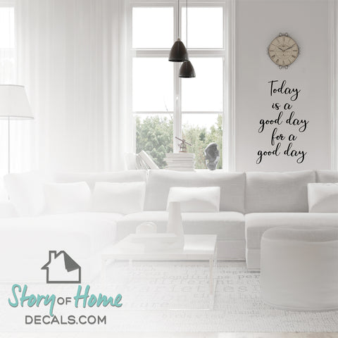 Vinyl wall decal that says, 'Today is a good for a good day' on a living room wall.