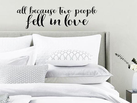 Wall decal for bedroom that says 'all because two people fell in love' on a bedroom wall.
