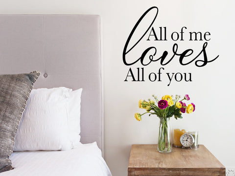 Wall decal for bedroom that says 'all of me loves all of you' on a bedroom wall.
