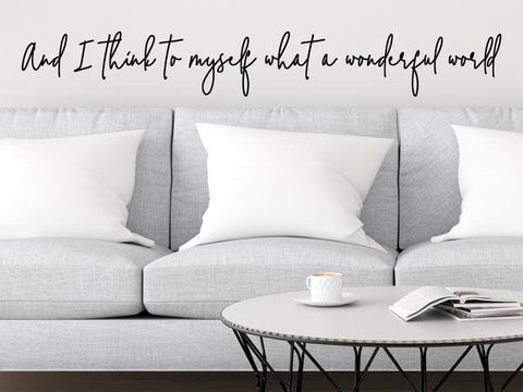 Living room wall decals that say 'And I think to myself what a wonderful world' on a living room wall.