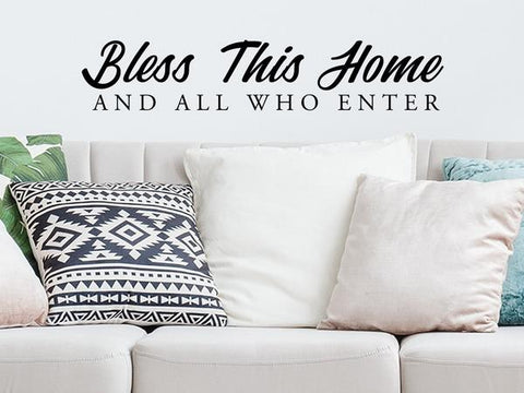 Living room wall decals that say 'Bless this home and all who enter' on a living room wall.
