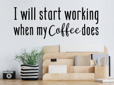 Wall decal for the office that says 'I will start working when my coffee does' on an office wall.