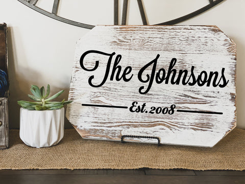 Wall art stick on for a custom wood sign that says ' The Johnson's established 2008'