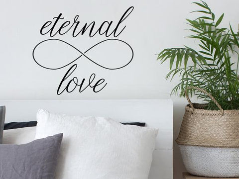 Wall decal for bedroom that says 'Eternal Love' on a bedroom wall.