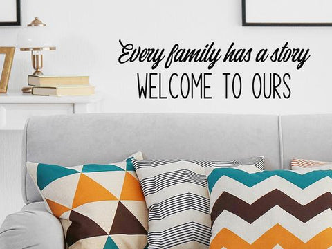 Wall decals for the living room that say, 'Every family has a story Welcome to ours' on a living room wall.