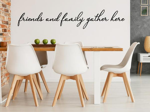 Wall decals for kitchen that say 'friends and family gather here' in a script font in a dining room.