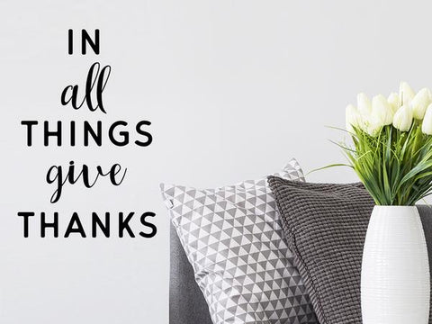 Wall decals for the living room that say, 'in all things give thanks' on a living room wall.