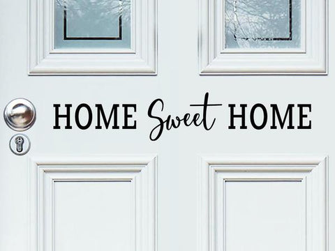 Front door decal that says, 'Home Sweet Home' on a front porch door.