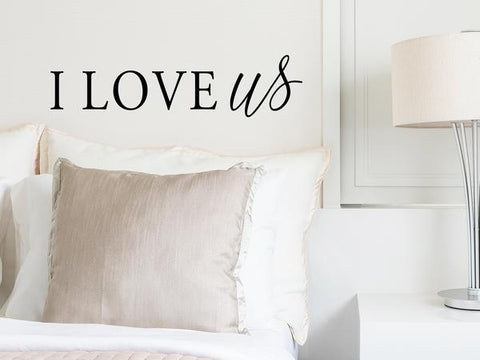 Wall decal for bedroom that says 'I love us' on a bedroom wall.
