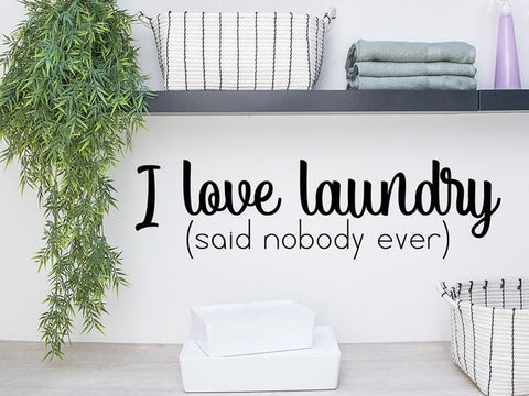 Laundry room wall decal that says 'I love laundry (said nobody ever)' on a laundry room wall.