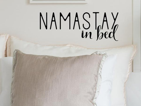 Wall decal for bedroom that says 'Namastay in bed' on a bedroom wall.