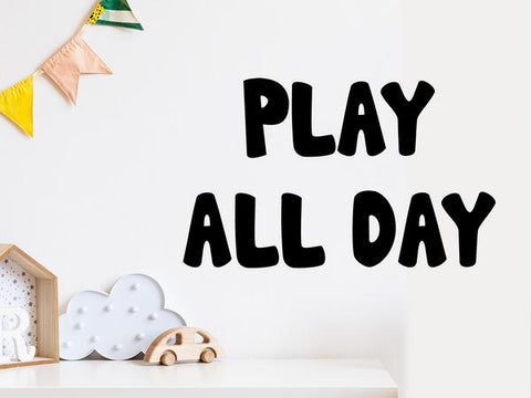 Wall decal for kids that says 'play all day' on a kid's room wall.