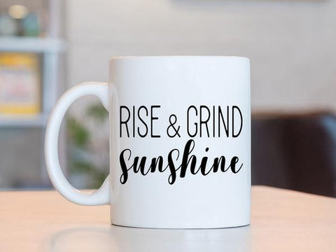 Custom Decals that say, 'rise and grind sunshine' on a coffee cup.