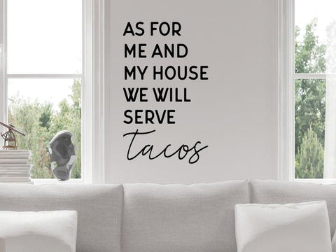 Living room wall decals that say 'as for me and my house we will serve tacos' on a living room wall.