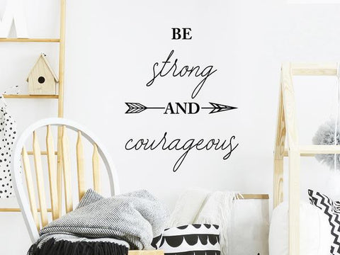 Wall decal for kids that says 'be strong and courageous' on a kid's room wall.