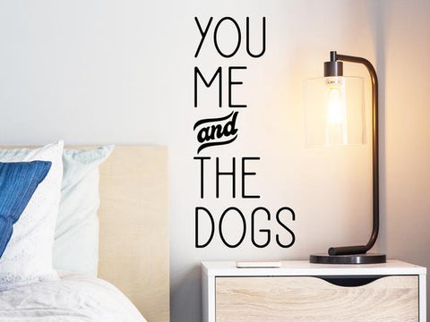 Wall decal for bedroom that says 'you me and the dogs' on a bedroom wall.