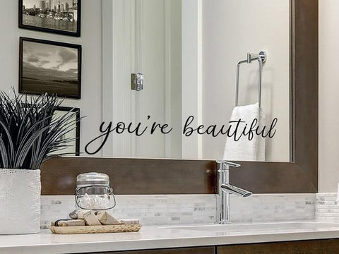 Wall decals for bathroom that say 'you're beautiful' on a bathroom mirror.
