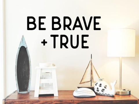 Wall decal for kids that says 'be brave and true' on a kid's room wall.