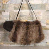 Recycled fur handbag and pompom