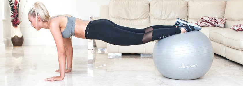 Girl Performing a Plank on a Proworks Exercise Ball