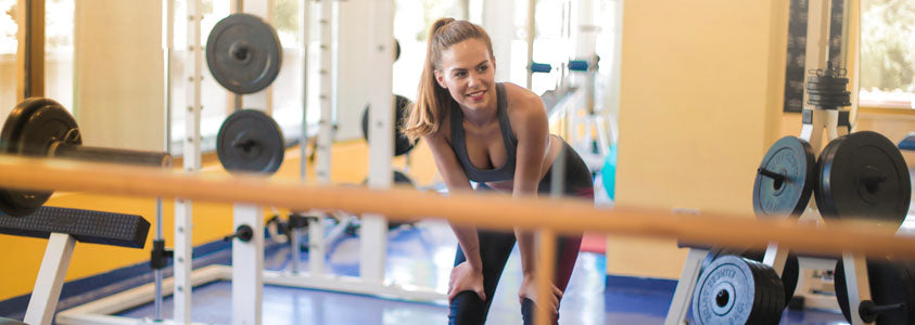 Woman Exercising in the Gym with Perfect Skin