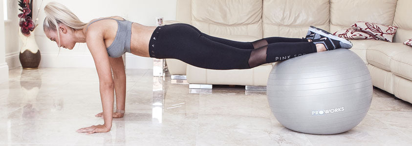 Girl Exercising with a Proworks Exercise Ball