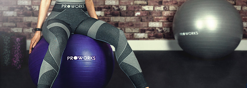 Girl Sitting on a Proworks Exercise Ball
