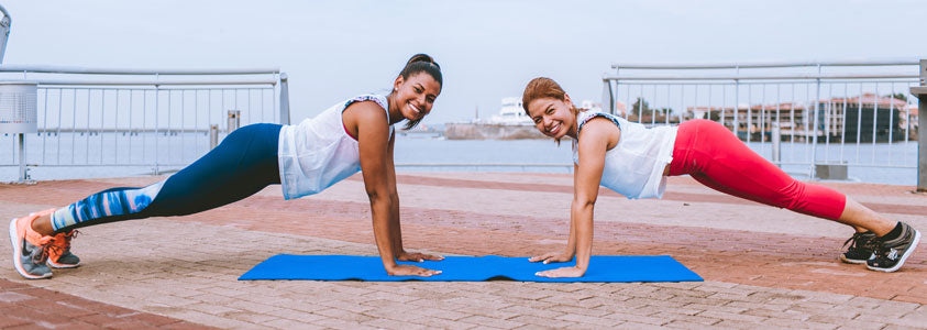 A Woman Working Out with Her Personal Trainer