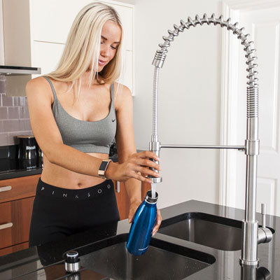 Girl Filling a Proworks Stainless Steel Water Bottle