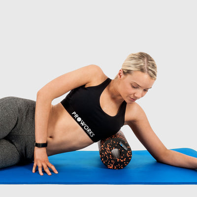Girl Exercising with a Proworks Foam Roller