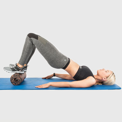 Girl Performing a Hip Bridge Using a Proworks Foam Roller