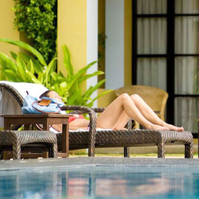 A Woman Relaxing by the Pool at a UK Spa