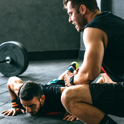 A Man Exercising with his Personal Trainer