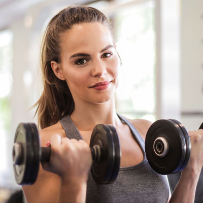 A Woman with Great Skin Working Out in the Gym