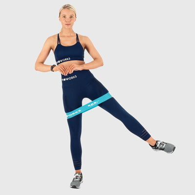 Girl Exercising with Proworks Resistance Bands