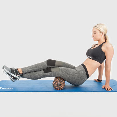 Girl Performing a Back of Thigh Roll Using a Proworks Foam Roller