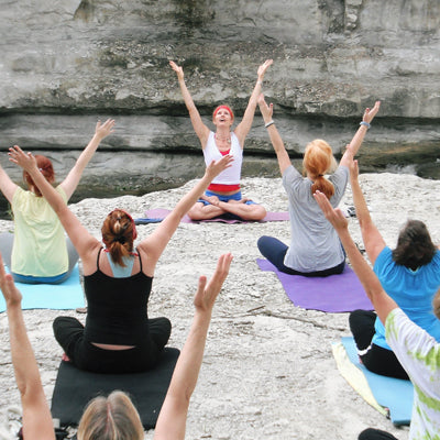 A Group of Women Performing Yoga and Meditating on a Hen Party