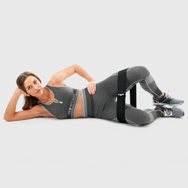 Girl Exercising with Proworks Black Glute Bands