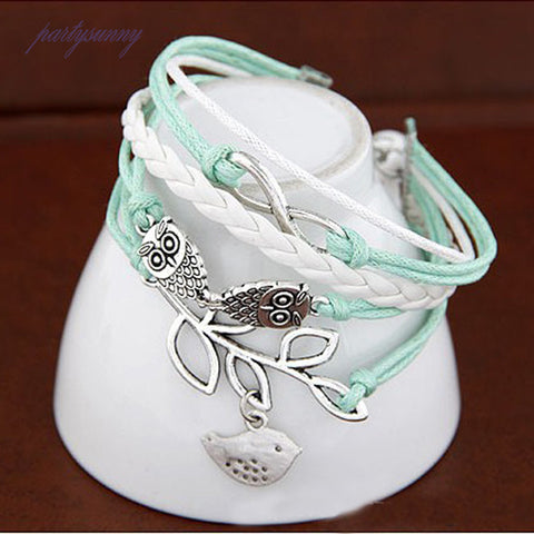 Image of Absolutely Lovely Owl Rope And Silver Color Metal Bracelet
