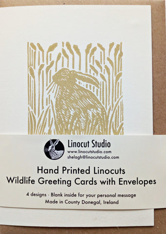 A selection of linocut wildlife greeting cards: Hare, Otter, Peacock and Squirrel.  Hand printed onto high quality Munken Pure Rough 350gsm card sourced from responsibly maintained forests and housed in recycled paper envelopes.  Size: A6. Blank inside for your personal message.
