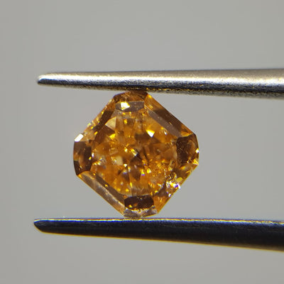 0.63 Carat RADIANT Shape ORANGE Color Diamond