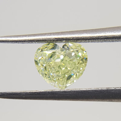 0.57 Carat HEART Shape YELLOW Color Diamond