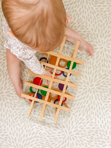 Child playing with Grapat loose parts.