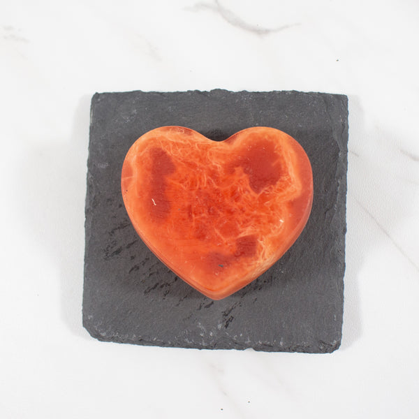 red heart shaped soap on slate