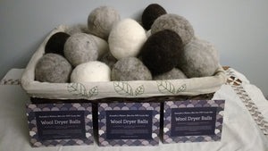 basket of natural wool dryer balls with info cards