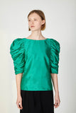 Green top with puffy sleeves