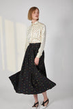 Black skirt with geometrical pattern