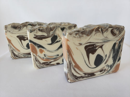 Bay Rum Handmade Soap - Classic cologne aftershave scent with Allspice, capers, cloves, nutmeg, crushed orange, pine needles, and a touch of patchouli and vanilla.  Ingredients:  Olive oil, coconut oil, organic palm oil, water, sodium hydroxide, shea butter, sweet almond oil, meadowfoam oil, caster oil, fragrance, kaolin clay, skin-safe colorants